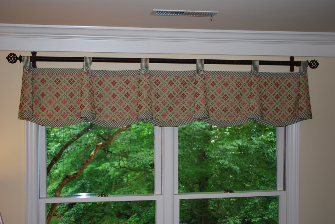 Scallop valance with bells mounted on wrought iron hardware for Catherine King Interiors