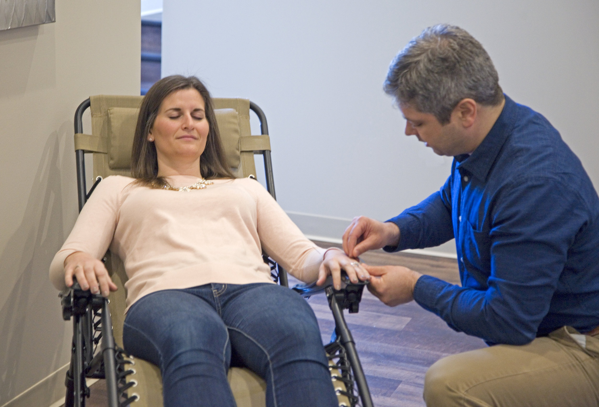 Acupuncturist Stephen Durell during treatment with a client at Grand Rapids Natural Health (photo)