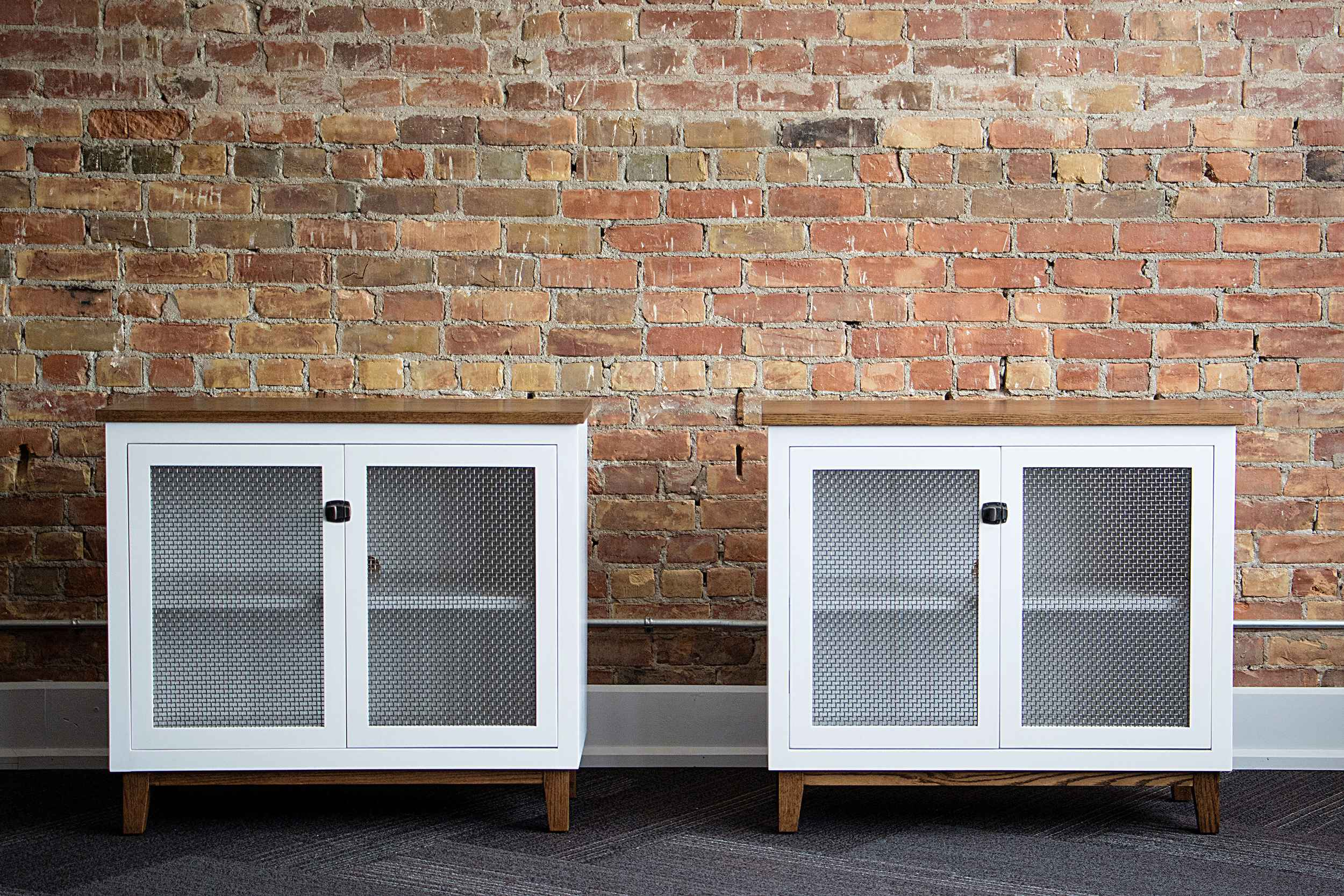 Custom painted speaker cabinets featuring solid oak base and top and steel mesh door panels.