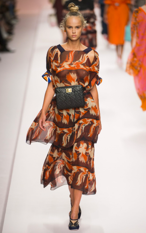Fendi SS19.  I used to be a diehard show-er of legs, after all who wants to hide their best asset? But I have to say no one wears midi better than us, Tall Girls. Also love the mix of sheer and patterns Fendi!