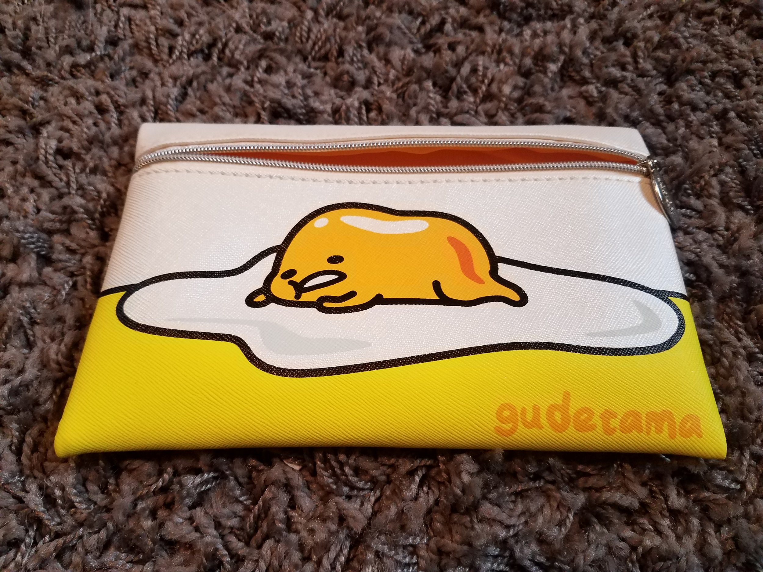 The front of bag features Gudetama in all his lazy glory