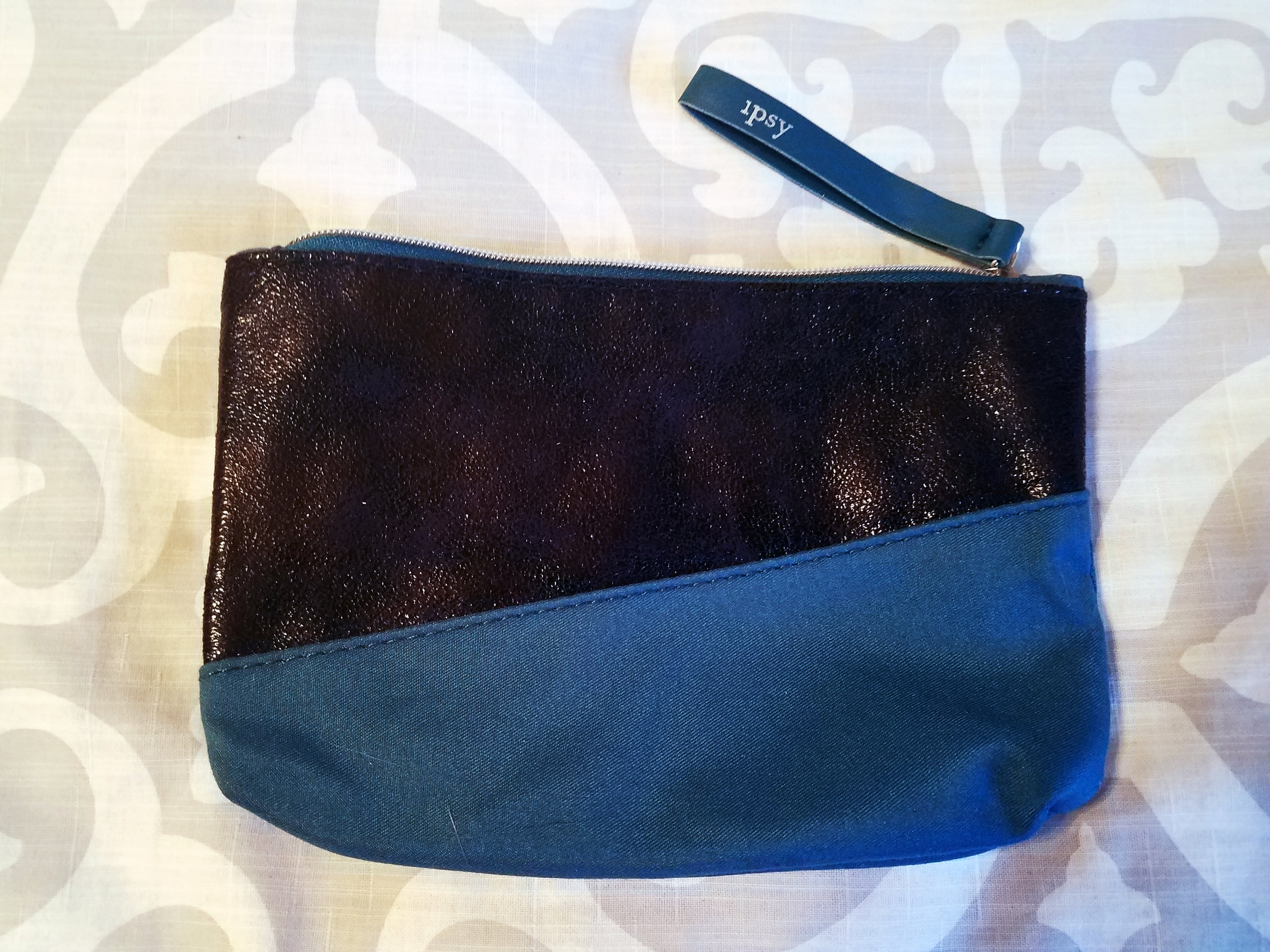 Novembers' bag features a two jewel-toned colored bag. Reg. Retail Price - $5.00
