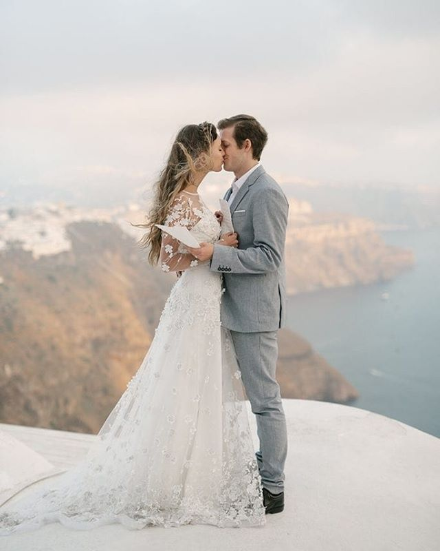 This photo was taken in Greece by my super talented friend @ashleebrookephoto. She is doing discounted mini sessions right now for Falltime photos- go check her out! *Blossom gown ⠀⠀⠀⠀⠀⠀⠀⠀⠀ #bridals #bridal #flowerweddingdress #dressdesigner #couture #weddinginspiration