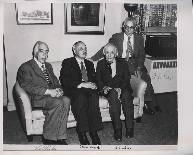 Niels Bohr sits on the left.