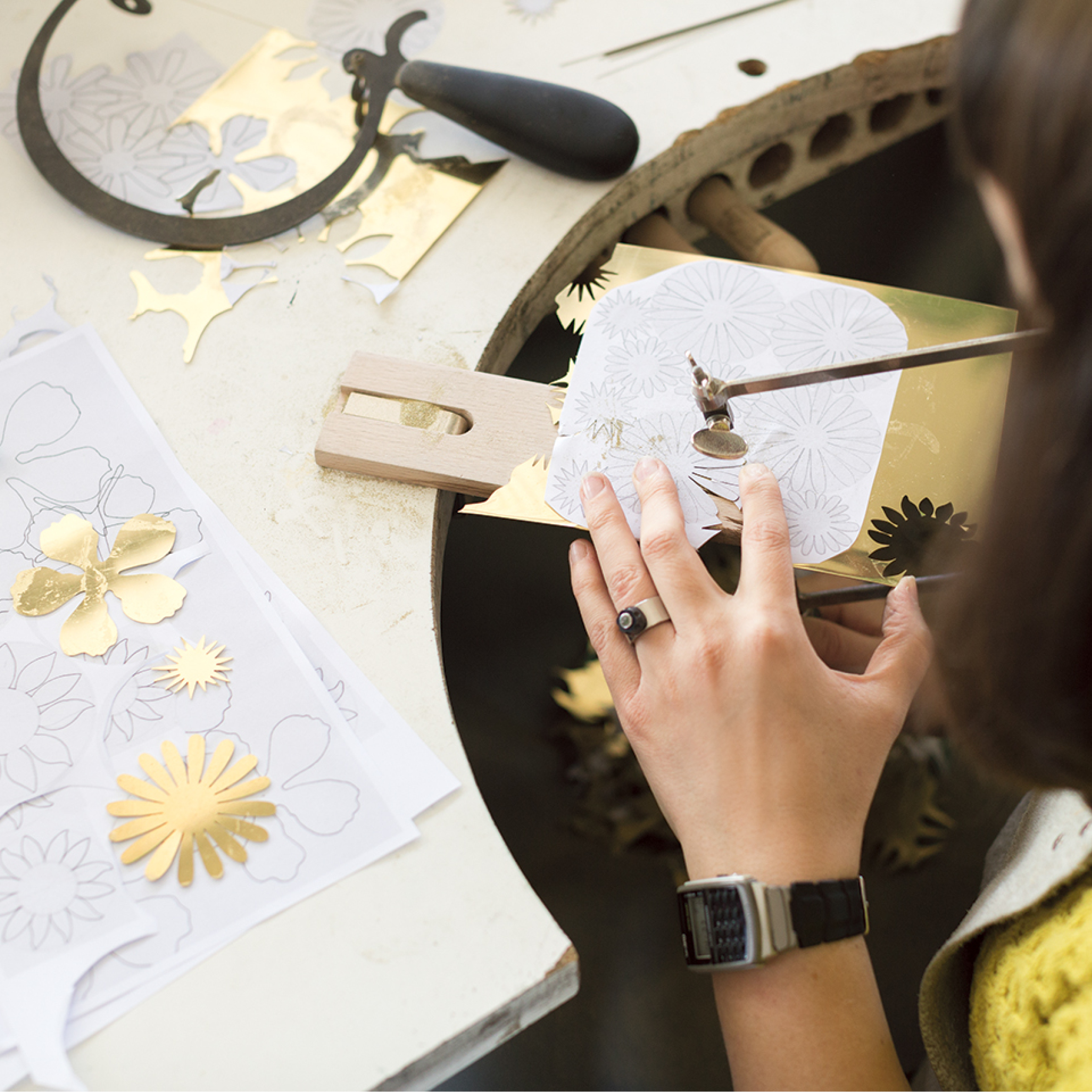 Saw piercing flower templates for the Martin Place permanent memorial.Photo by Bri Hammond