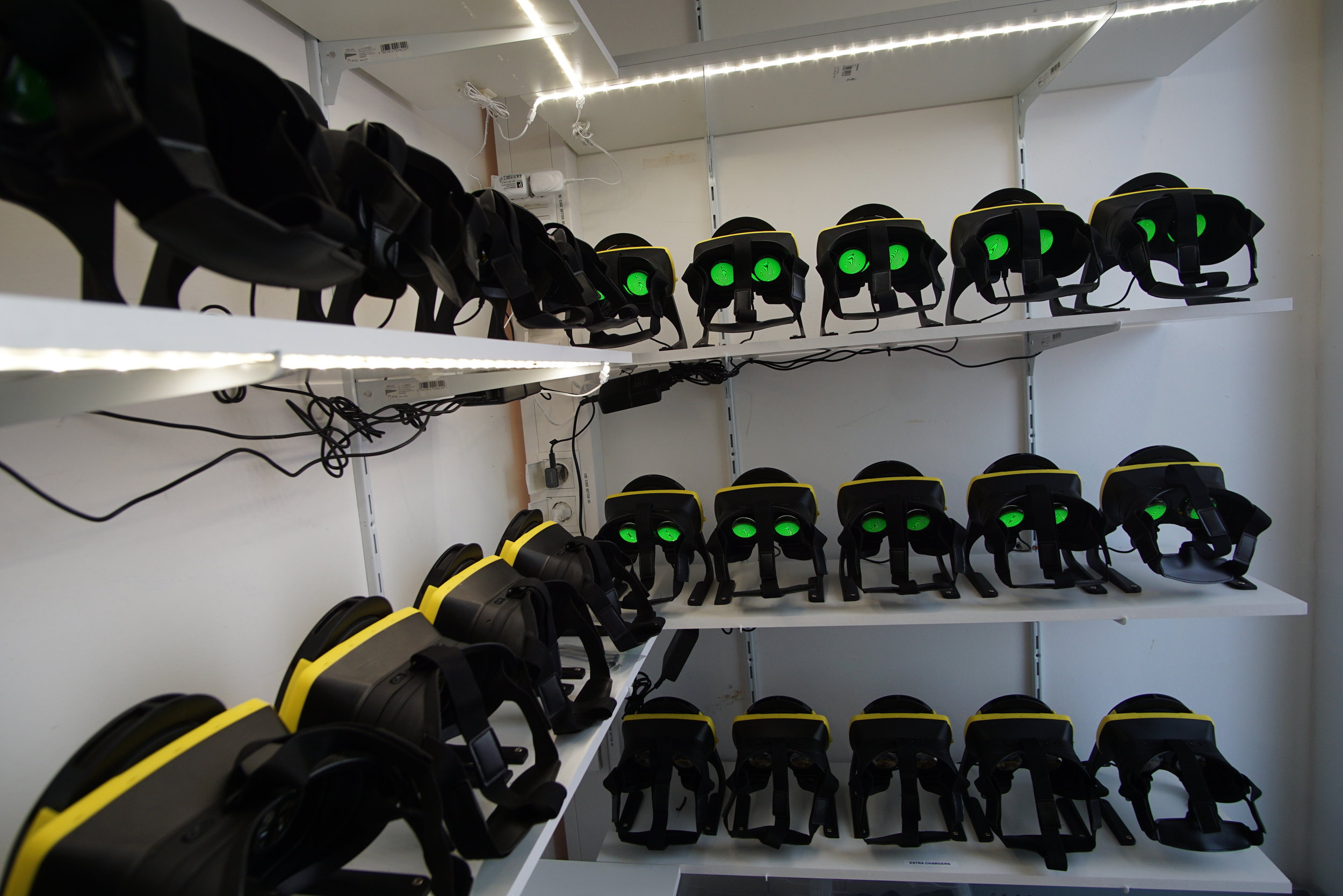 Charging cabinet and analytics - At the end of operation, each headset docks in a charging cabinet and wirelessly sends information from that day's operations to our secure servers. We deliver high quality analytic reports about rider capacity, content selection and headset performance.
