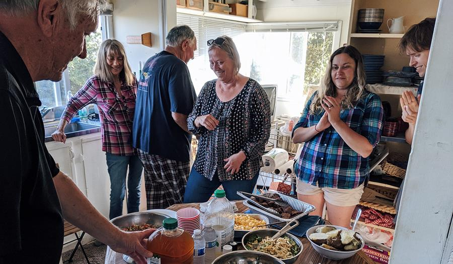 Work party participants get ready to feast after a good day's work.