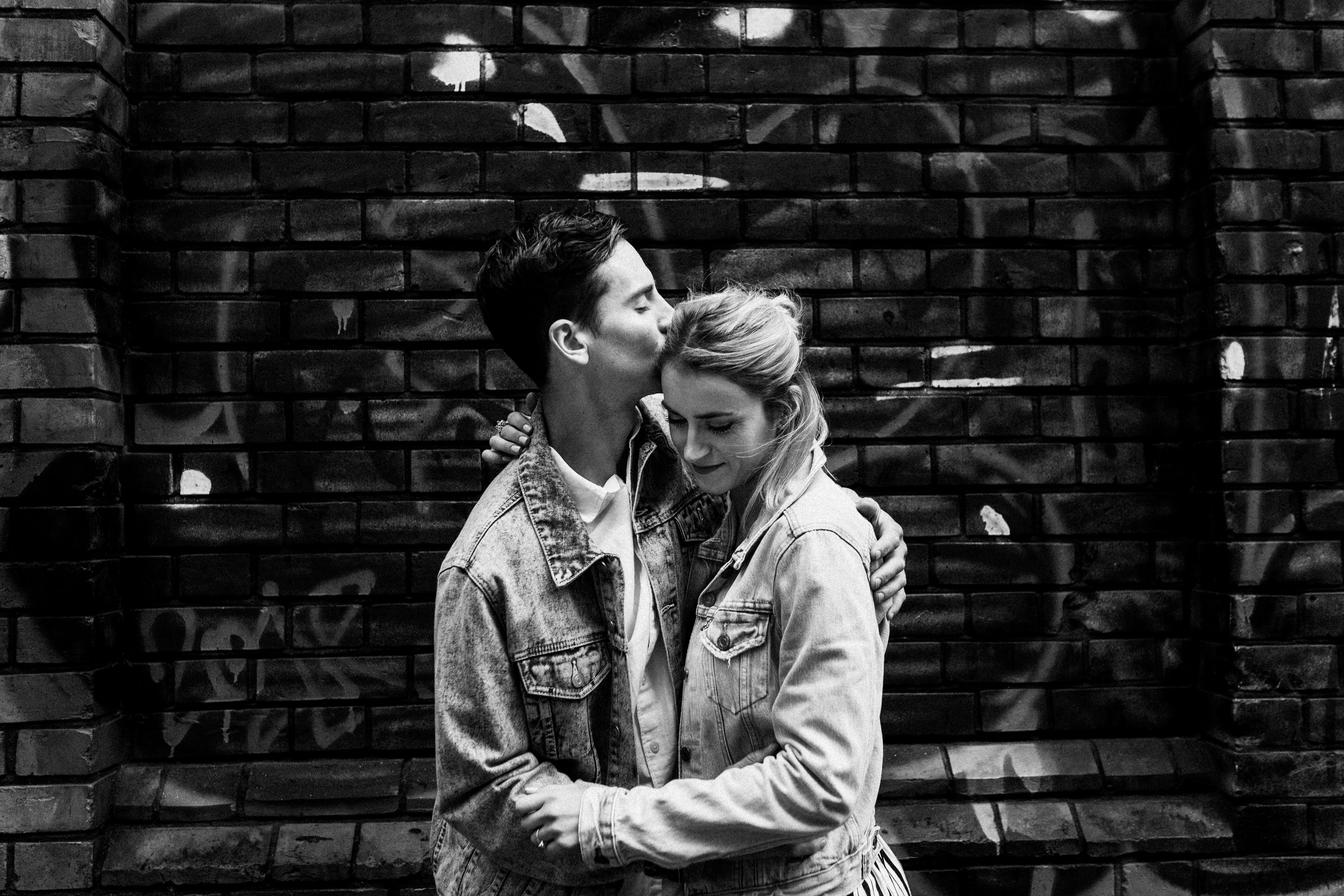 Couple embrace during their pre-wedding photoshoot in Brick Lane.
