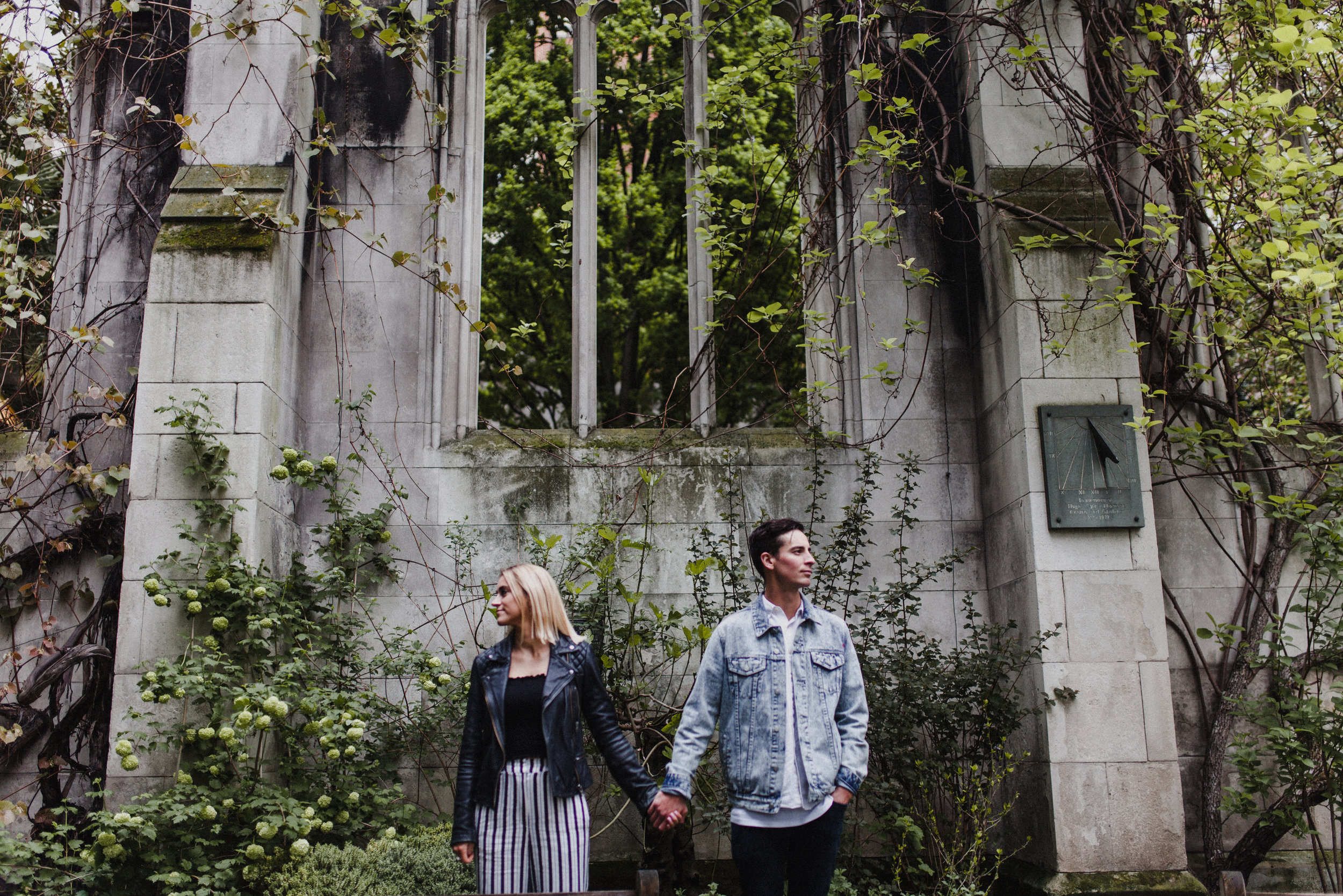 Couple pose for a portrait in the grounds of St Dunstan-in-the-East, a ruined church in London