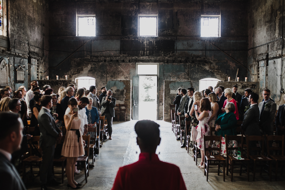 Guests await the brides arrival at her Asylum Chapel Wedding