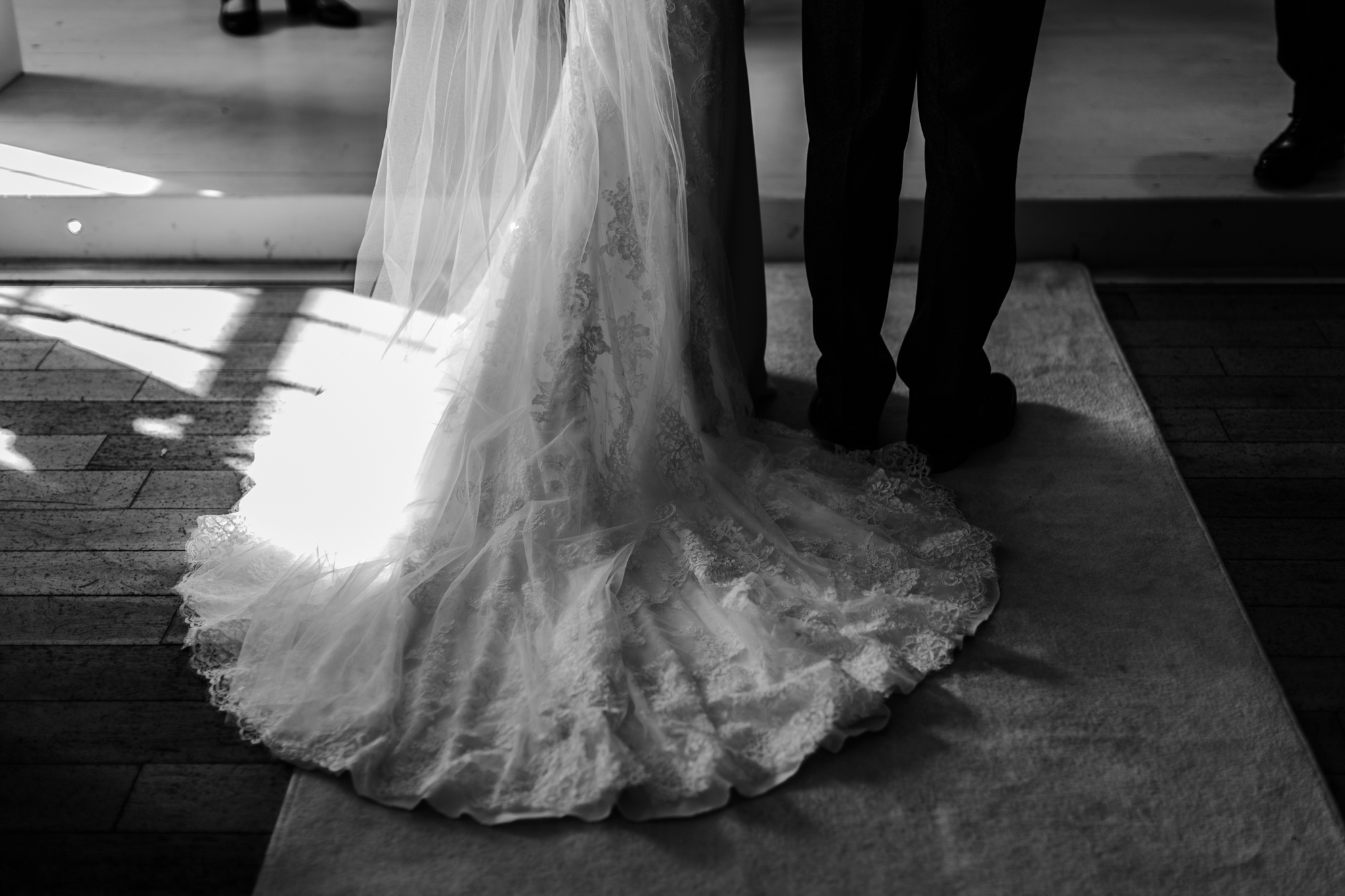 Detail of wedding dress and suit