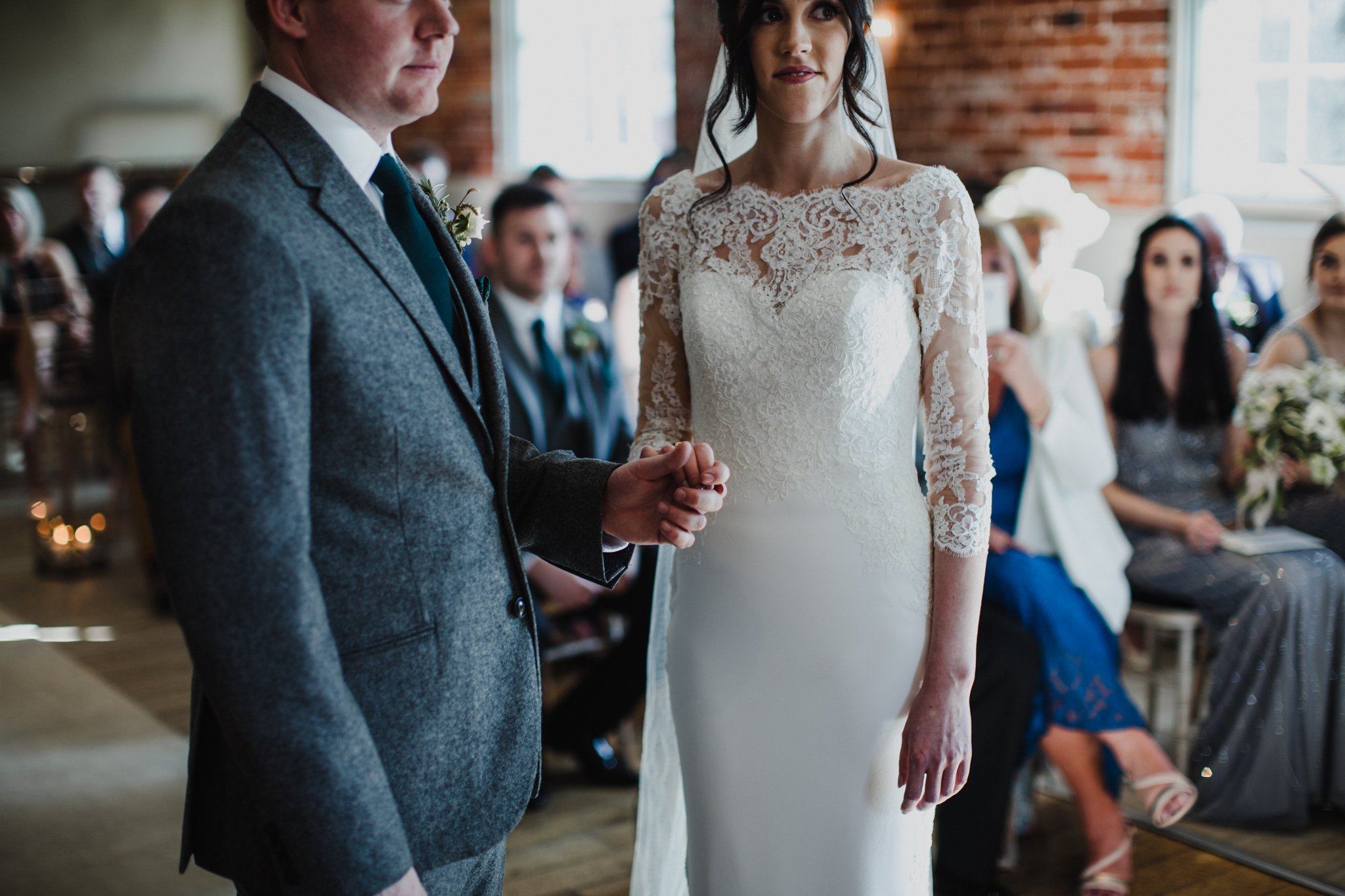medium view of bride and groom holding hands
