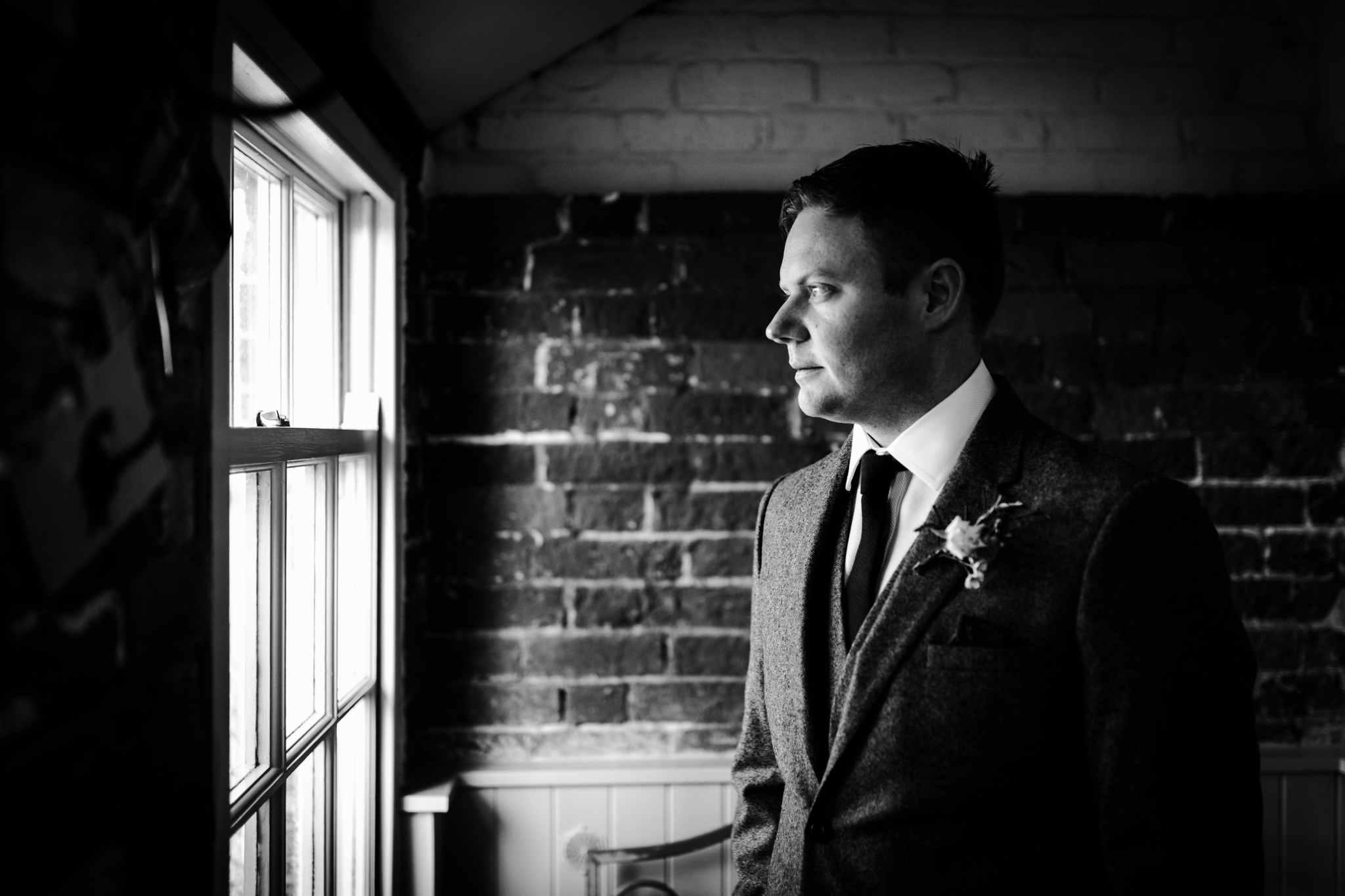Groom gazing out the window