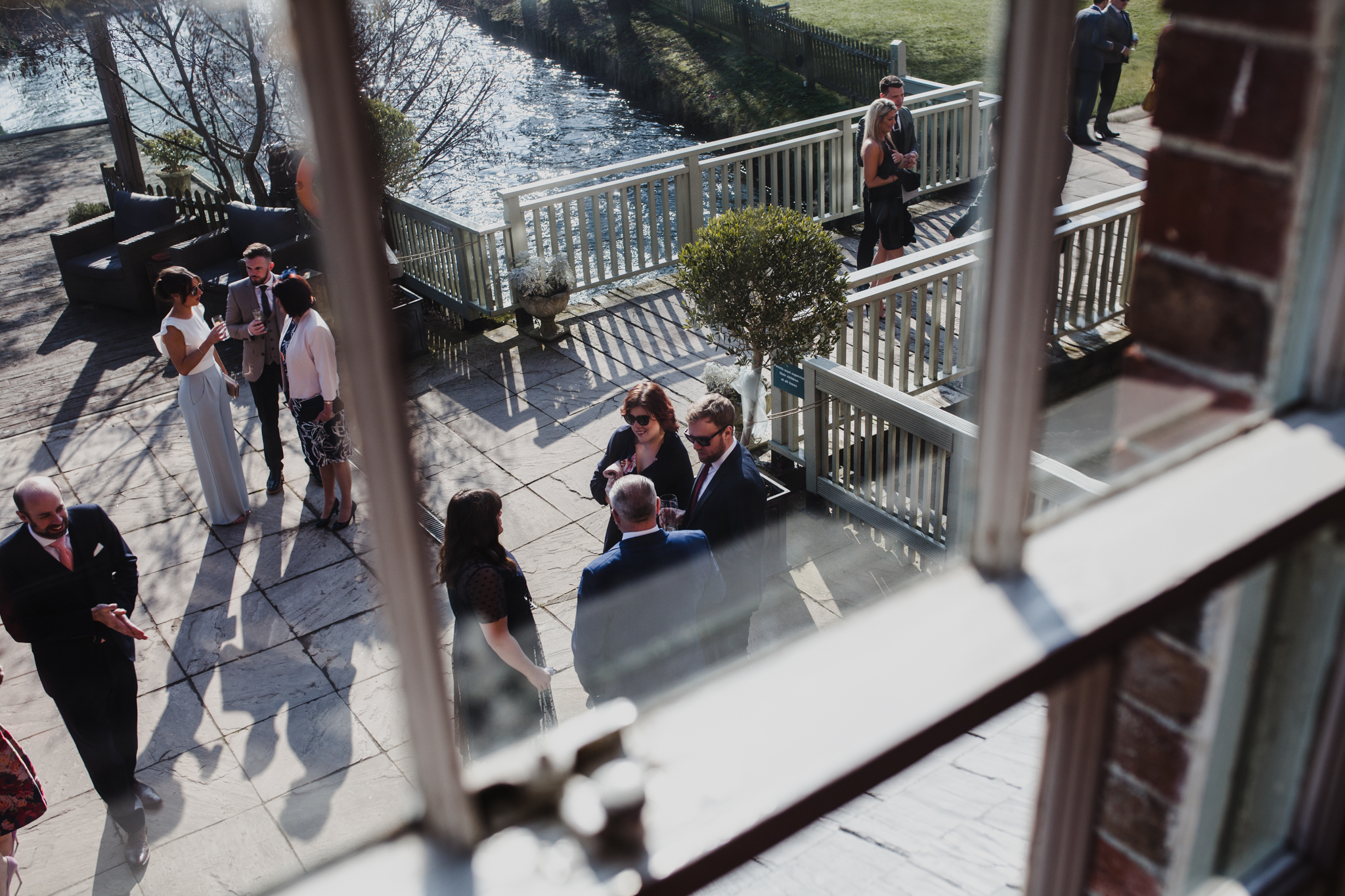 View out the window of wedding guests