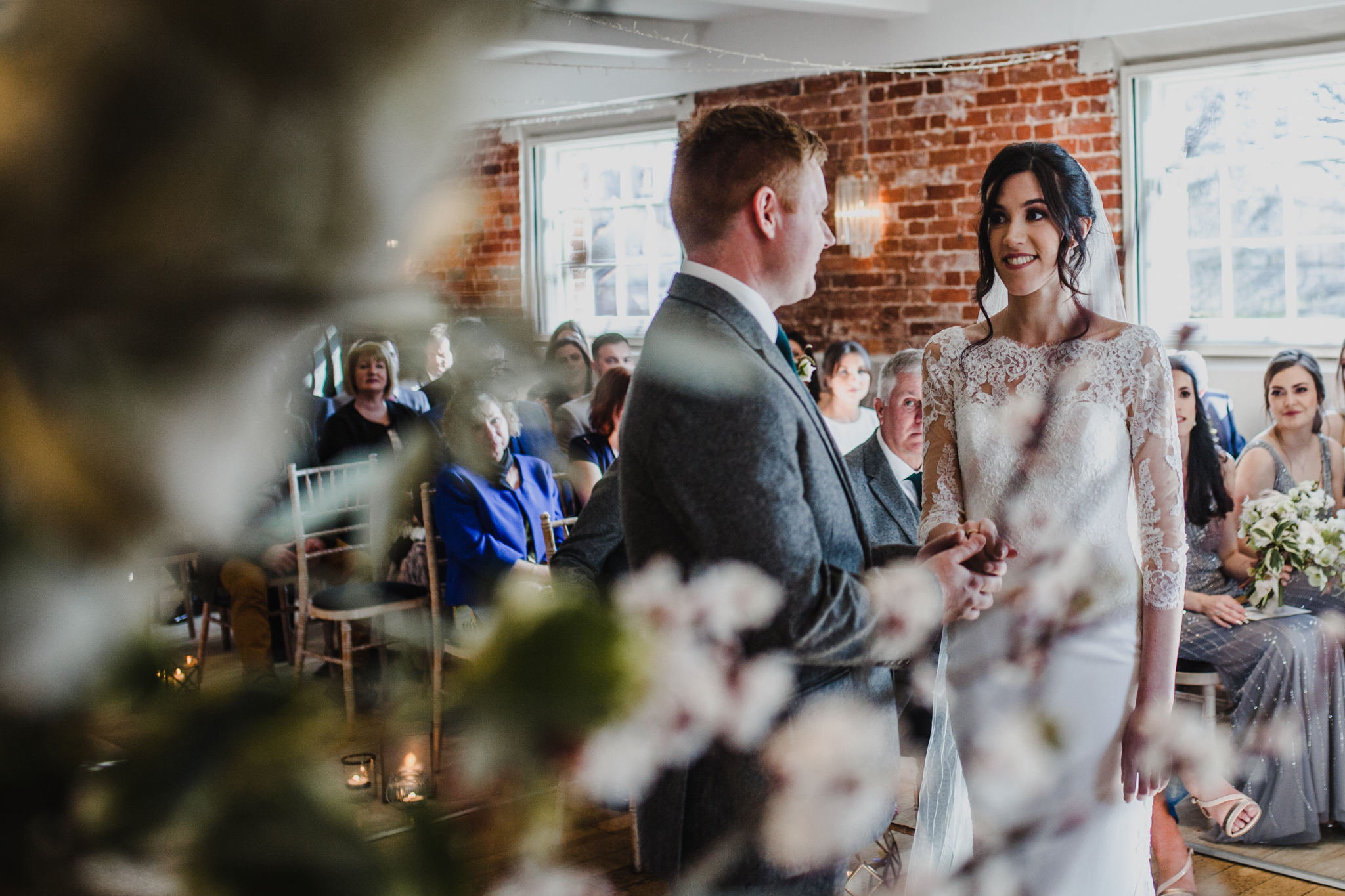 Image of bride and groom through theFlowers