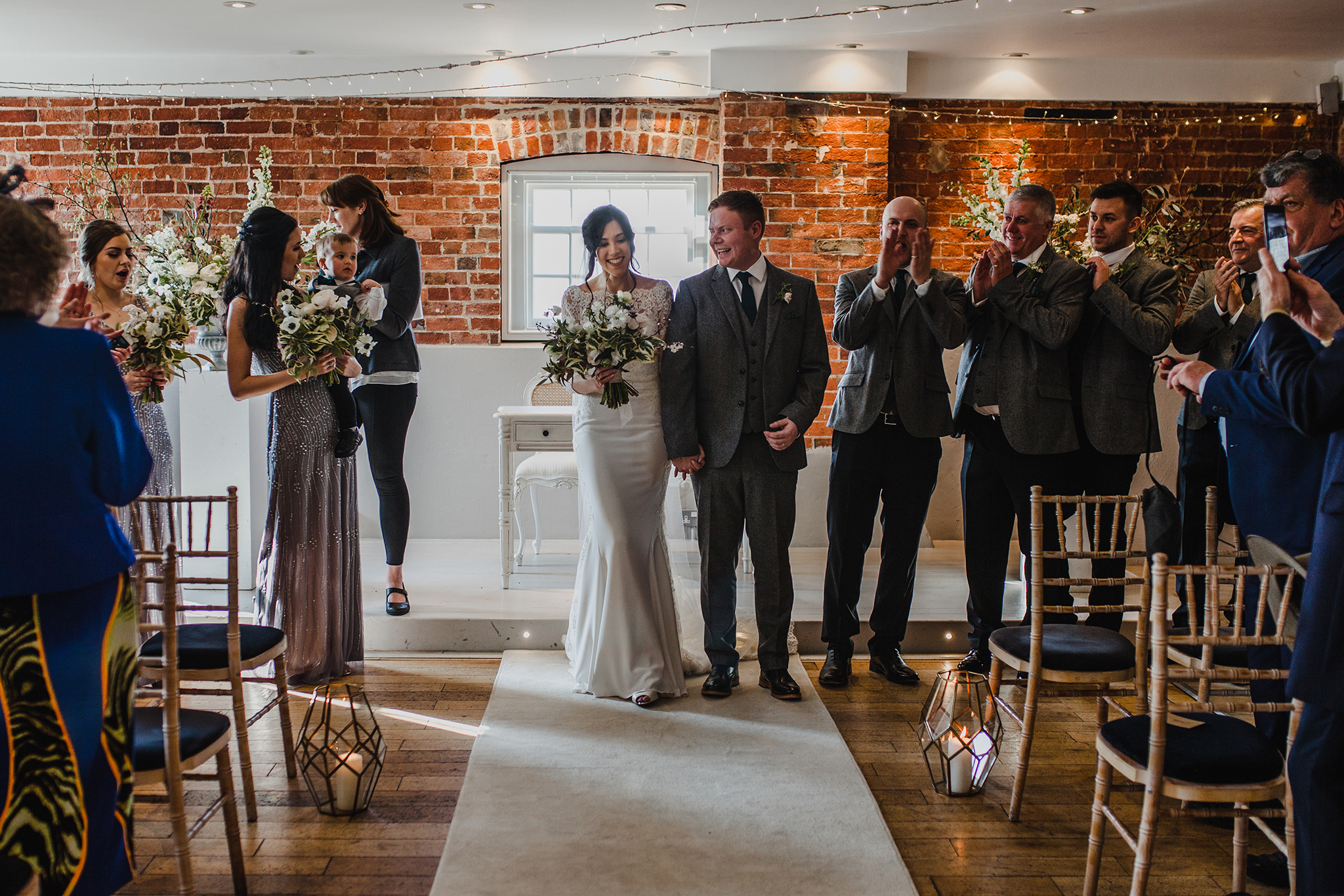wide view of wedding room with bridal party