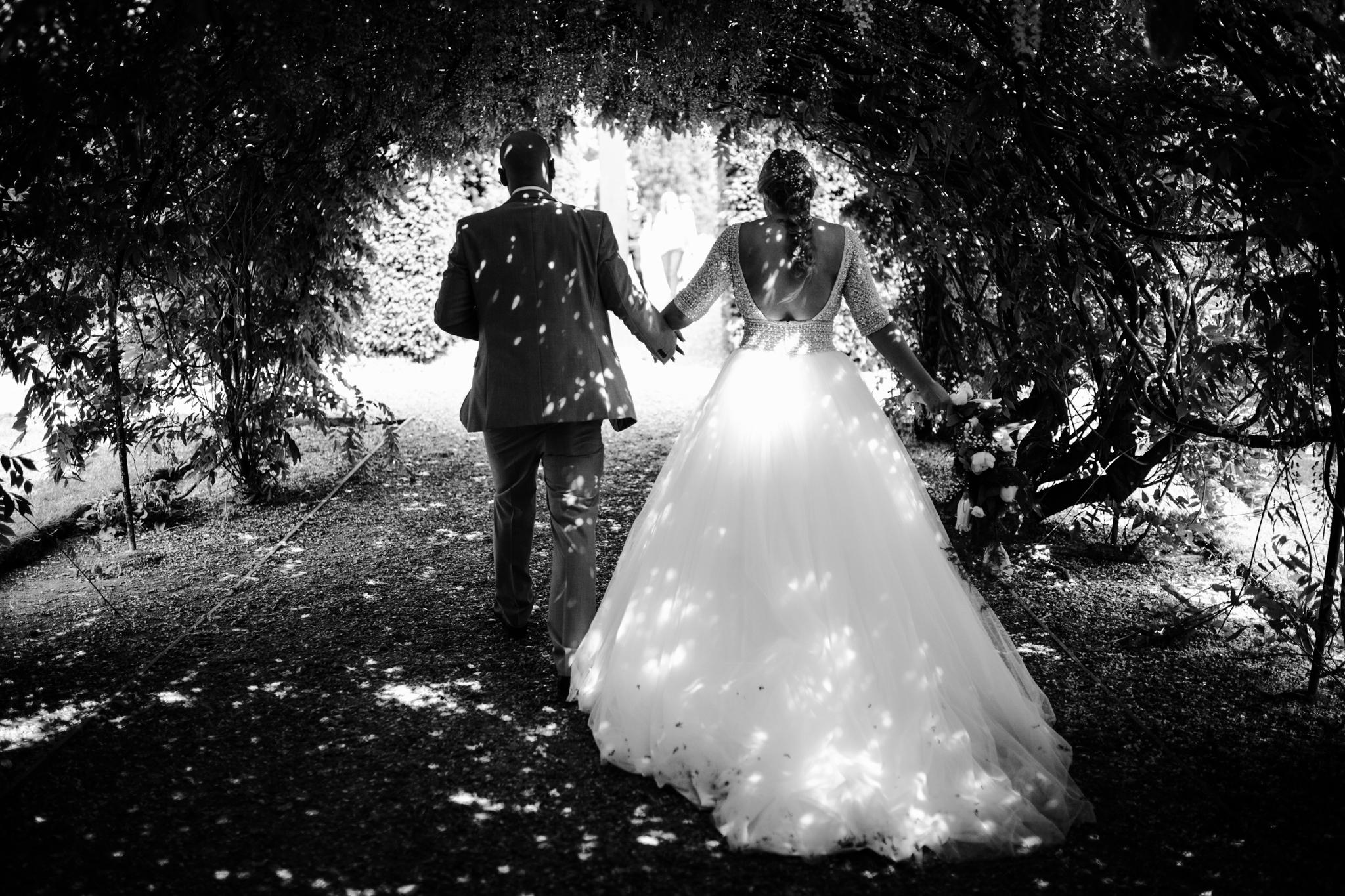 dappled light on bride and groom