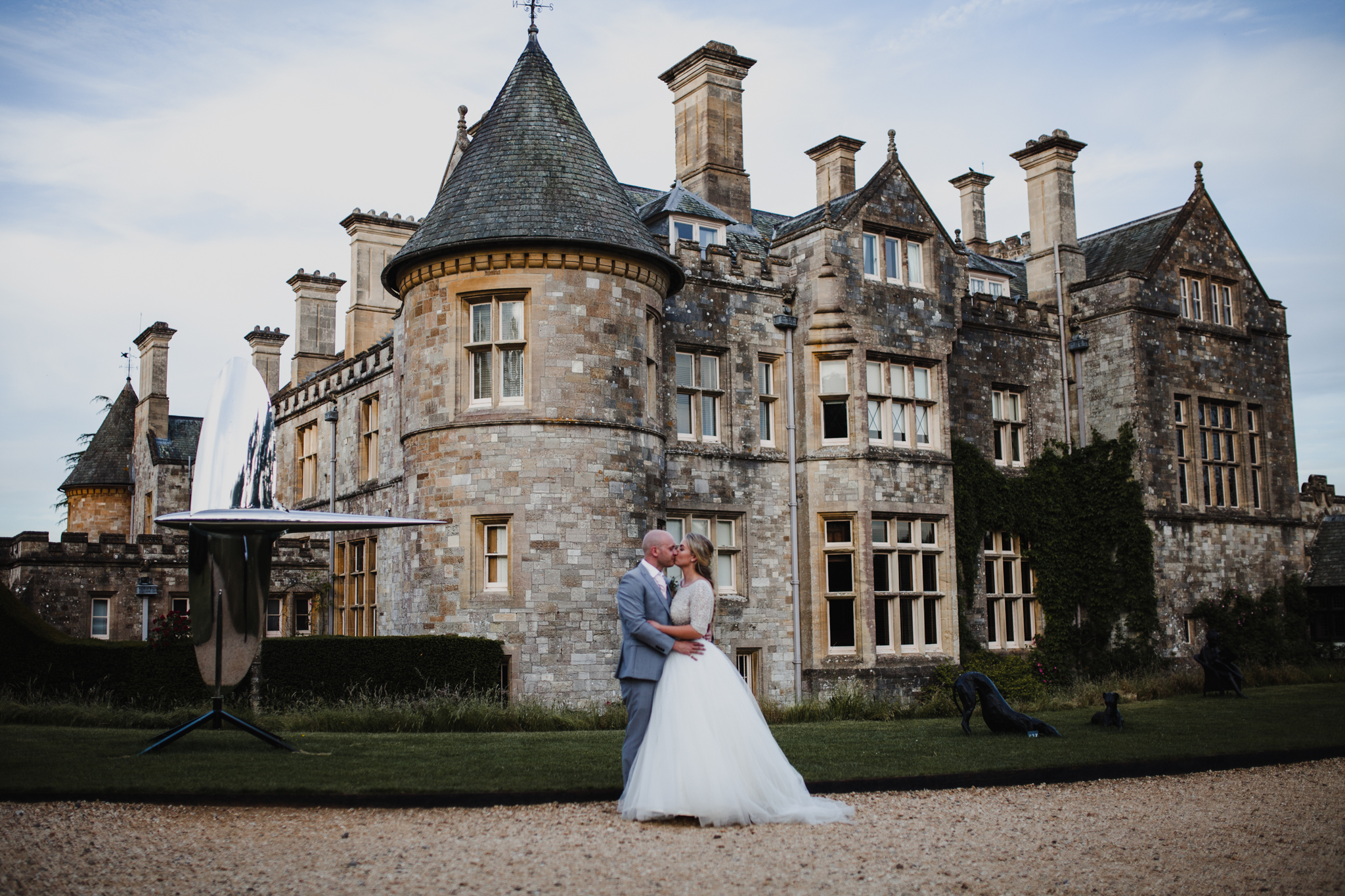 English castle with bride and groom kissing