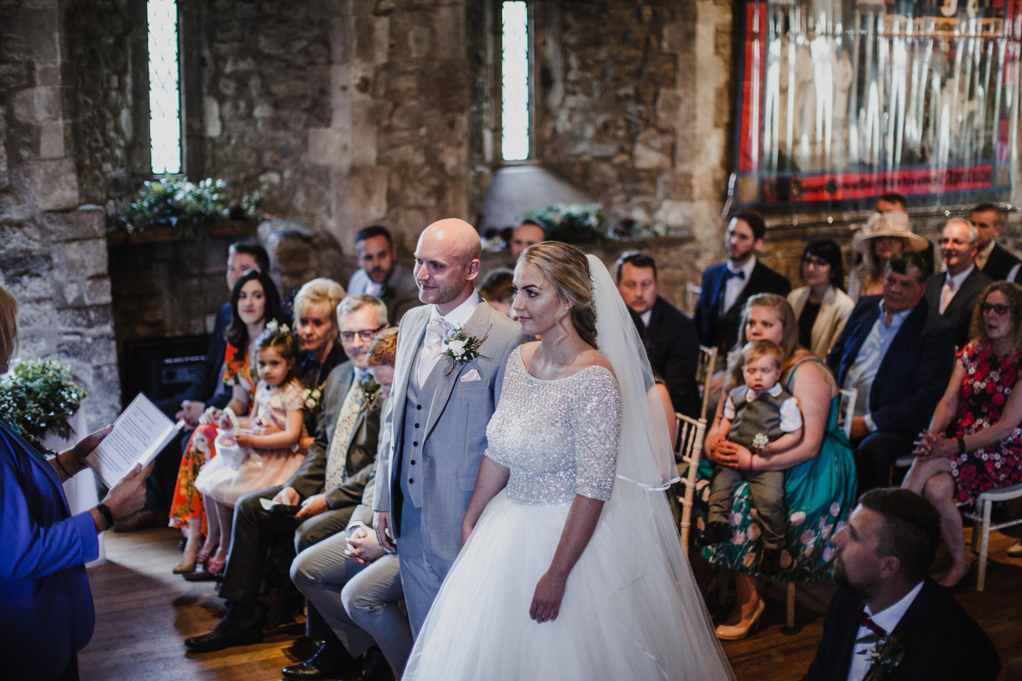 Bride and groom getting married in tudor style wedding venue