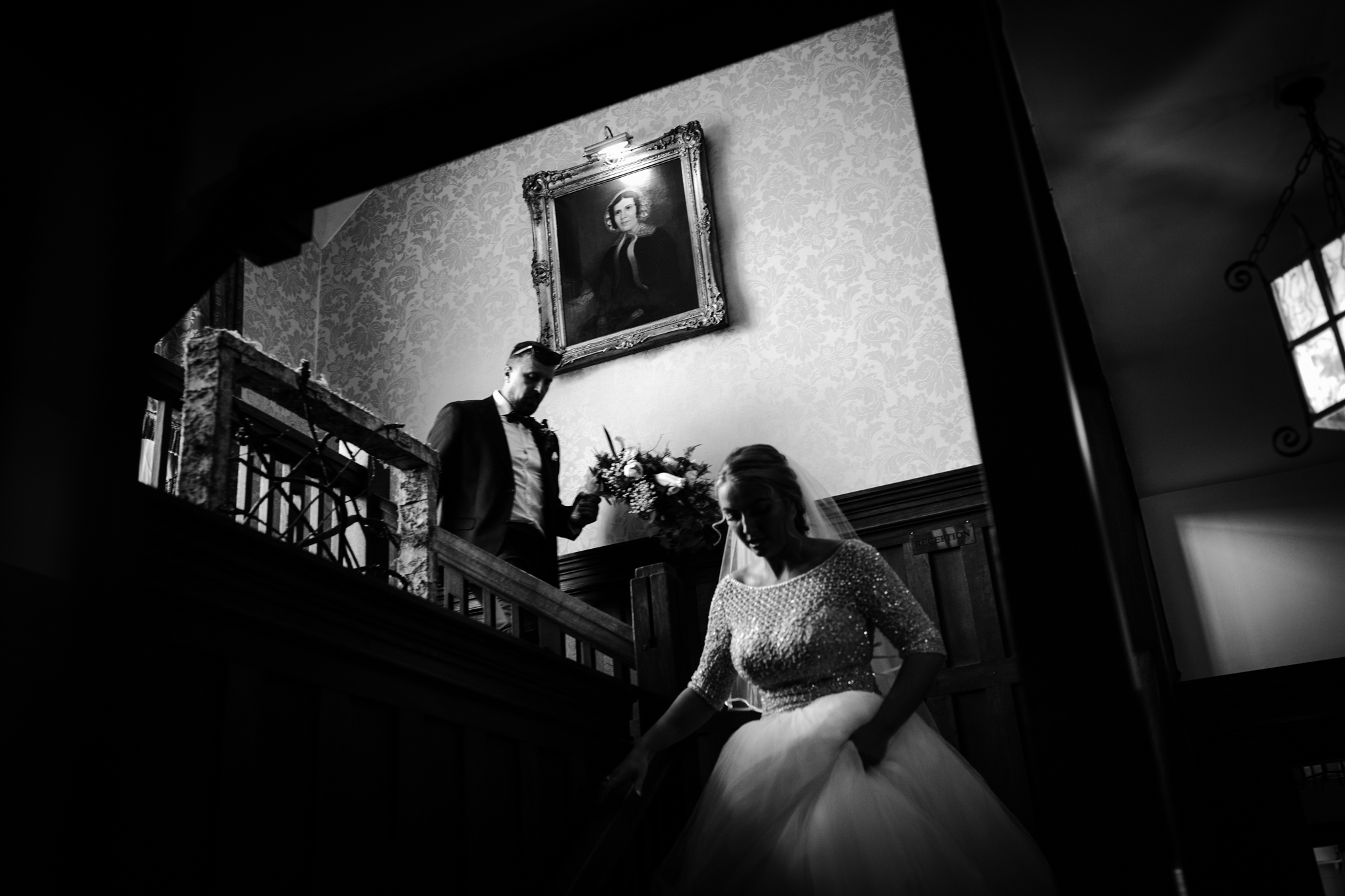bride and her father walking down the stairs before the wedding