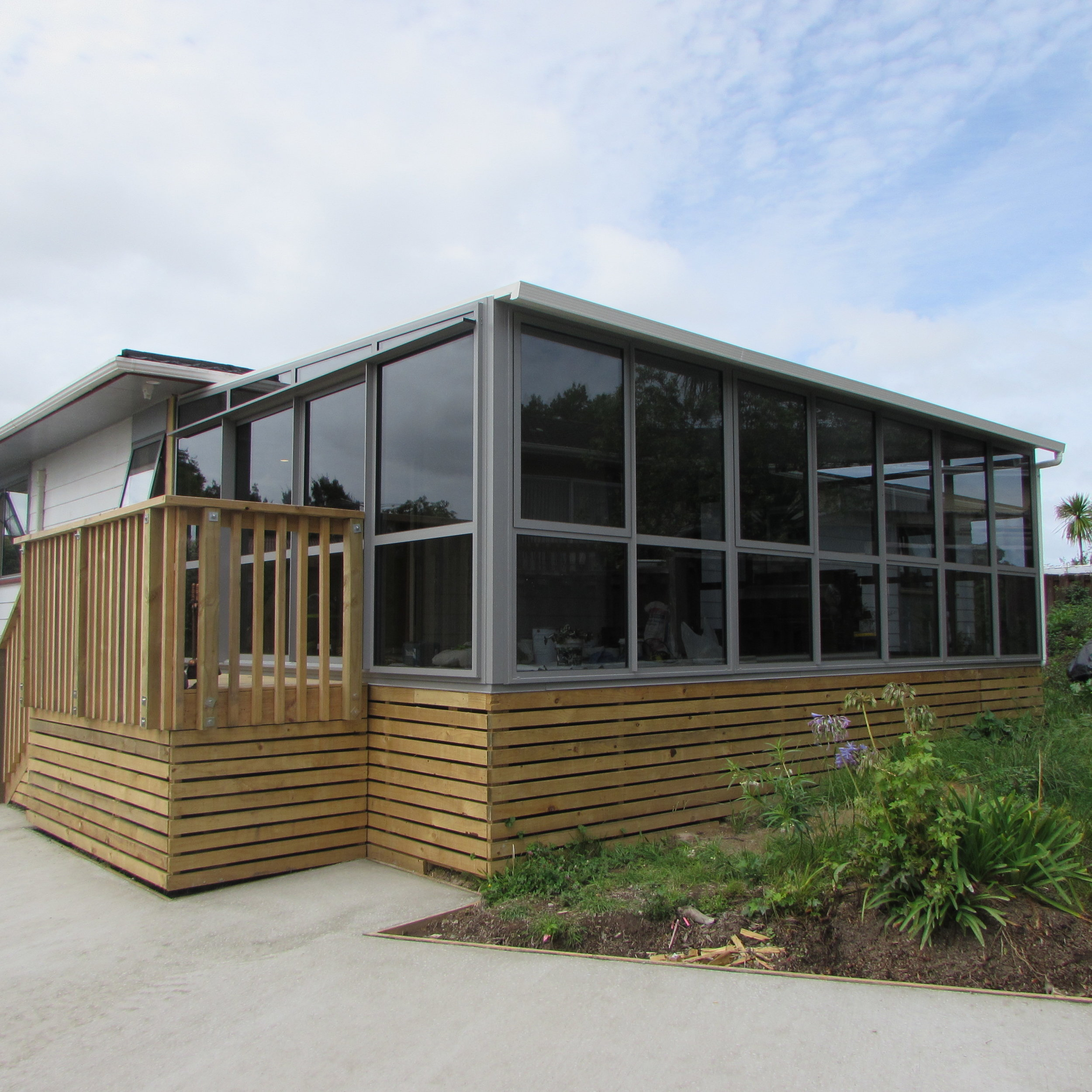 Existing building extension to small deck
