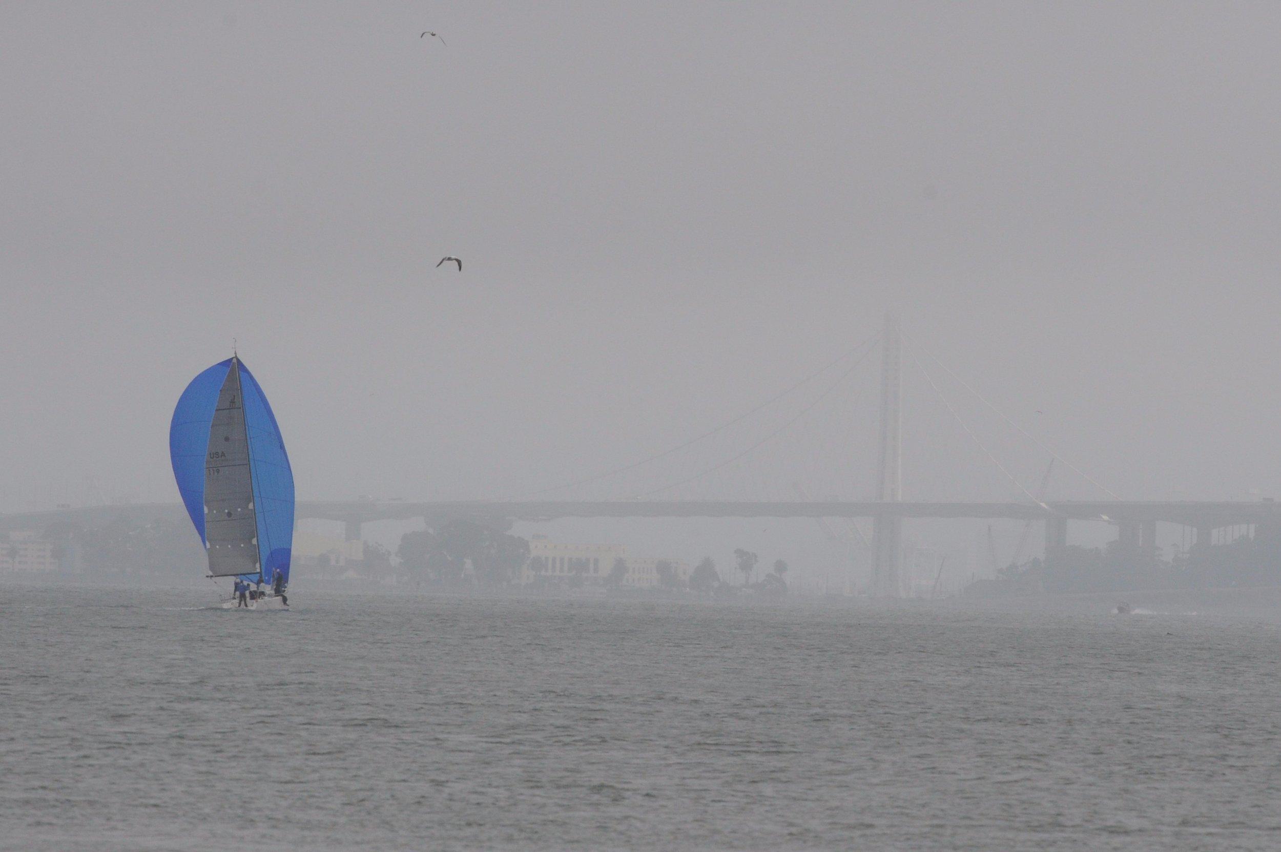 Sailboat headed towards the Bay Bridge.