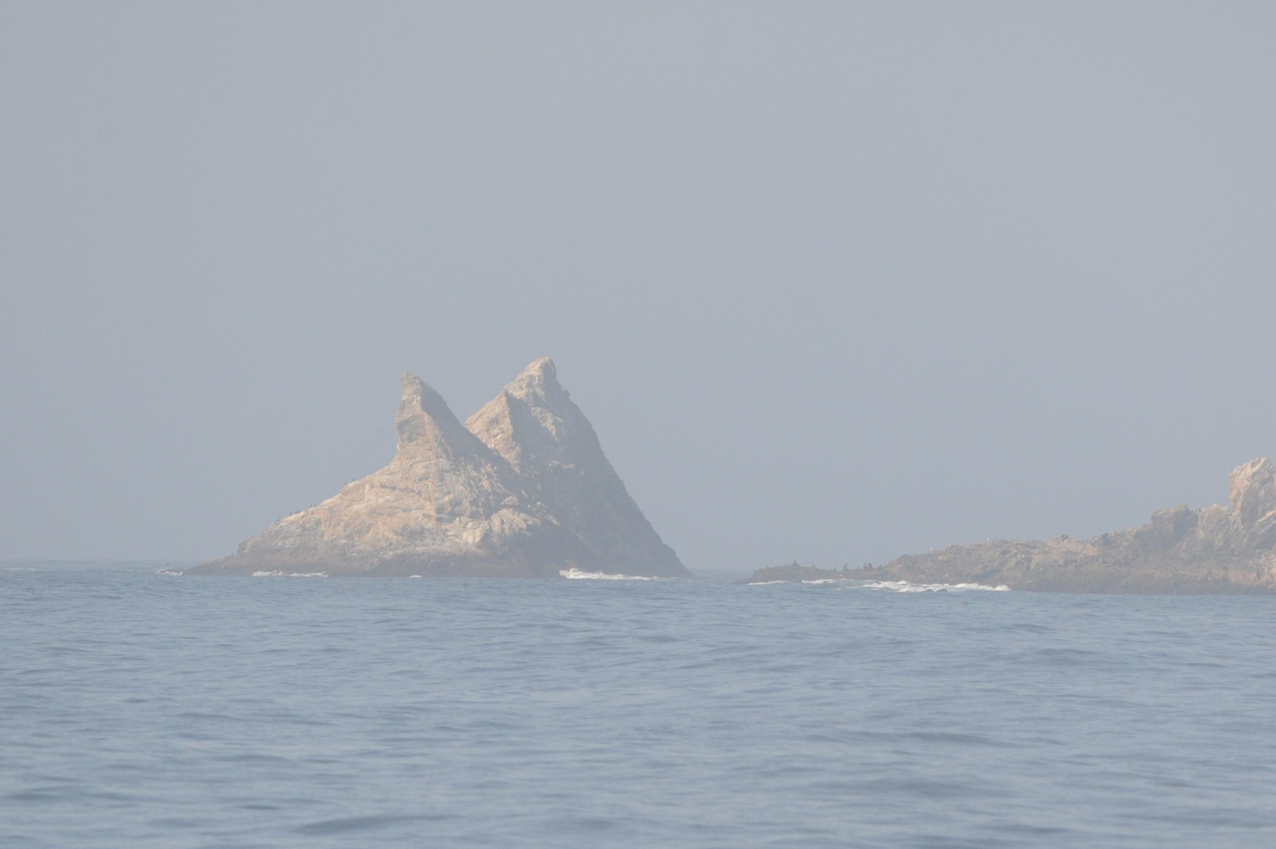 Saddle Rock appearing out of the mist.