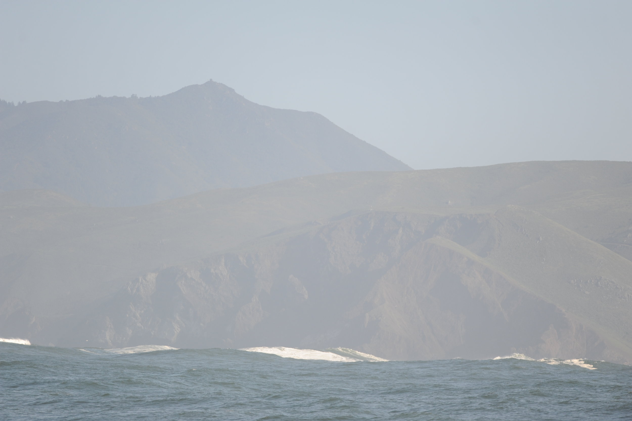 Big swells in front of the headlands.