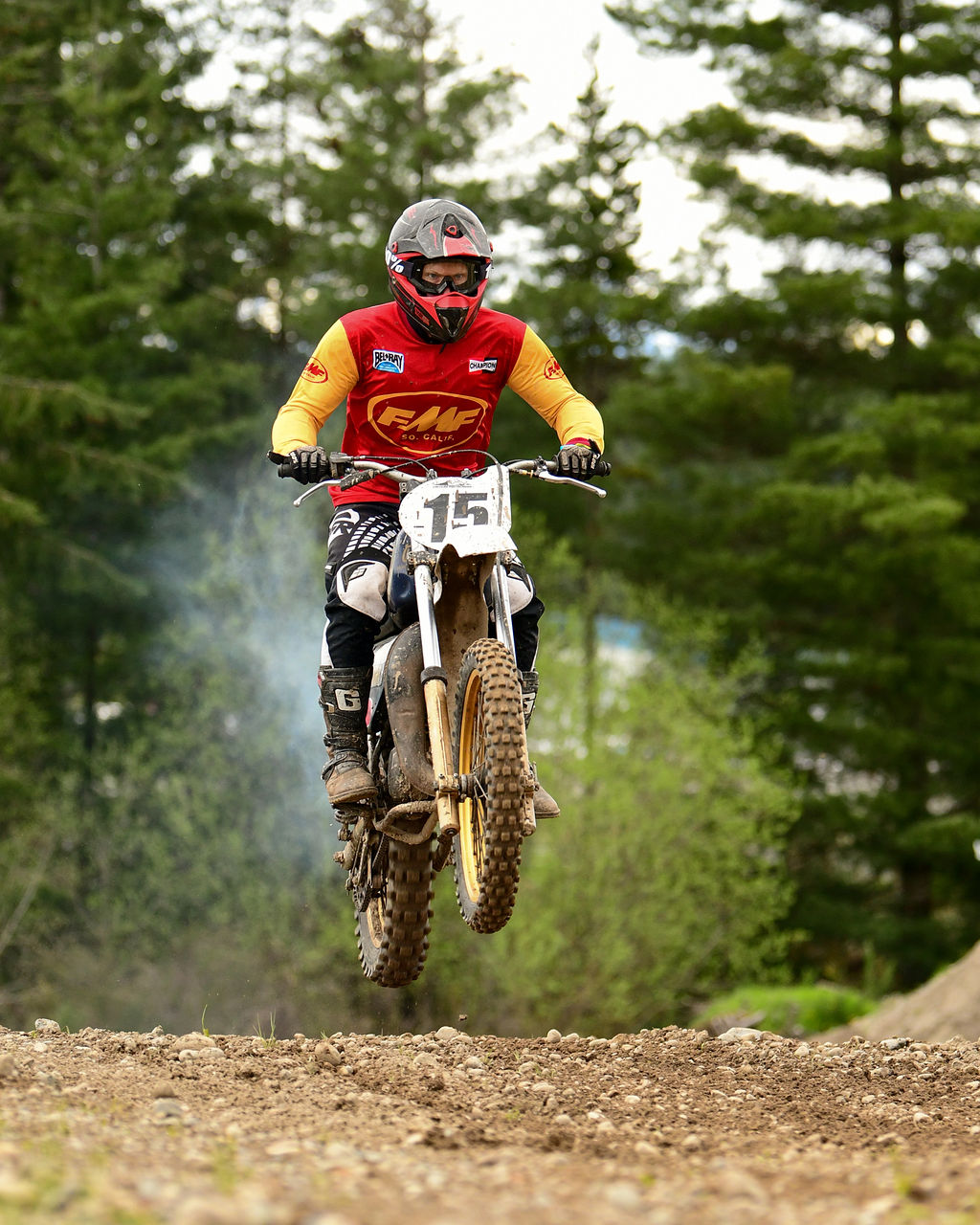 Isaac Siegl racing his Husqvarna WR250 in Vintage Motocross