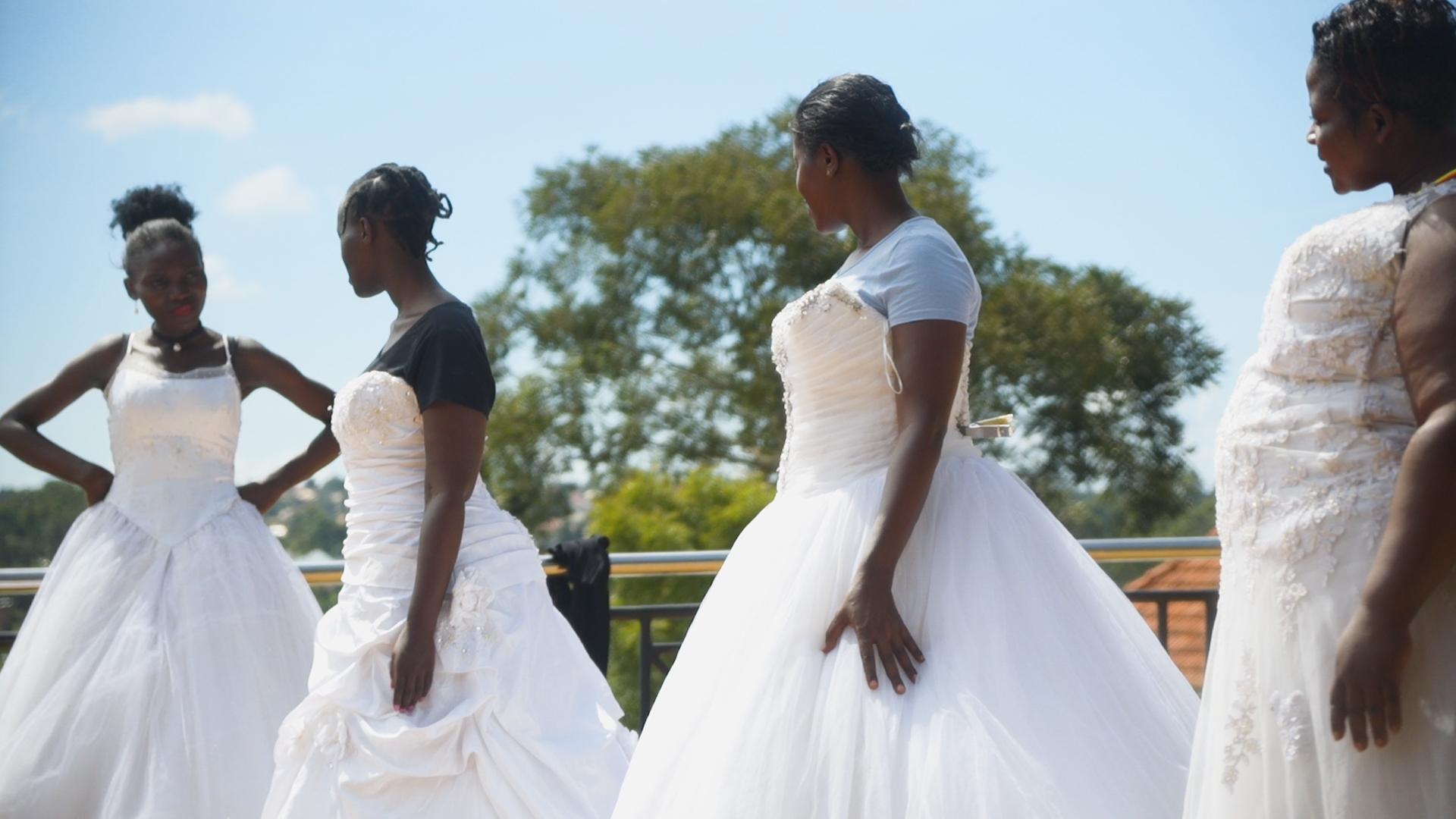 Miss Tourism teaching Miss Curvy Uganda contestants.jpg