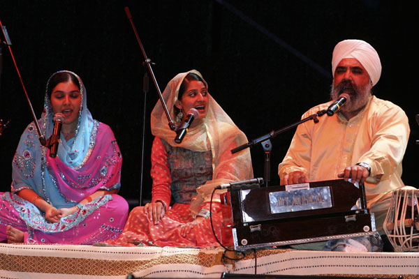 DYA Singh at harmonium with his two daughters