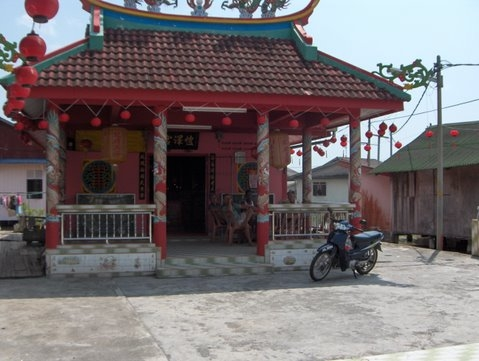 temple stands solid on kukup floating village.jpg