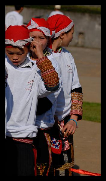 red dao tribe in their usual garb, and a t-shirt.jpg