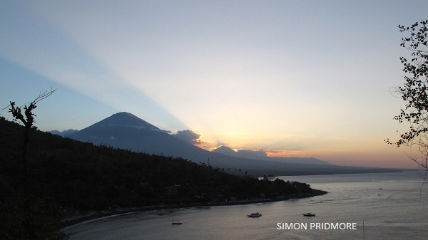 The attractions of geotourism in Bali is clear: mountainous spine of Mts Agung, Abang and Batur stand tall and beyond that Mt Batukaru in the hazy distance.
