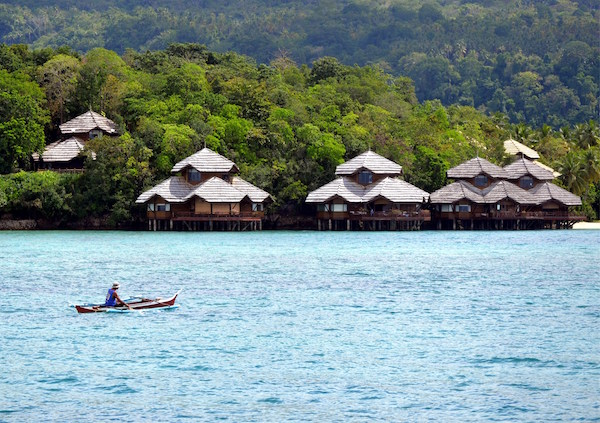 """These waterfront bunAgalows on Malipano Island of the Philippines were designed by world-renowned Architect Francisco """"Bobby"""" Mañosa, inspired by the stilt houses of the Sulu Sea using native materials such as bamboo, coconut and yakal."""
