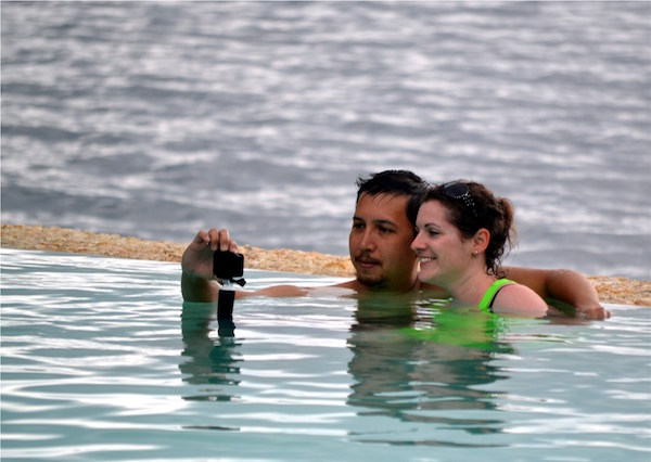 Carl Jr. and wife Tina from the US bask in the beauty of Samal Island from the infinity pool of Pearl Farm Beach Resort.