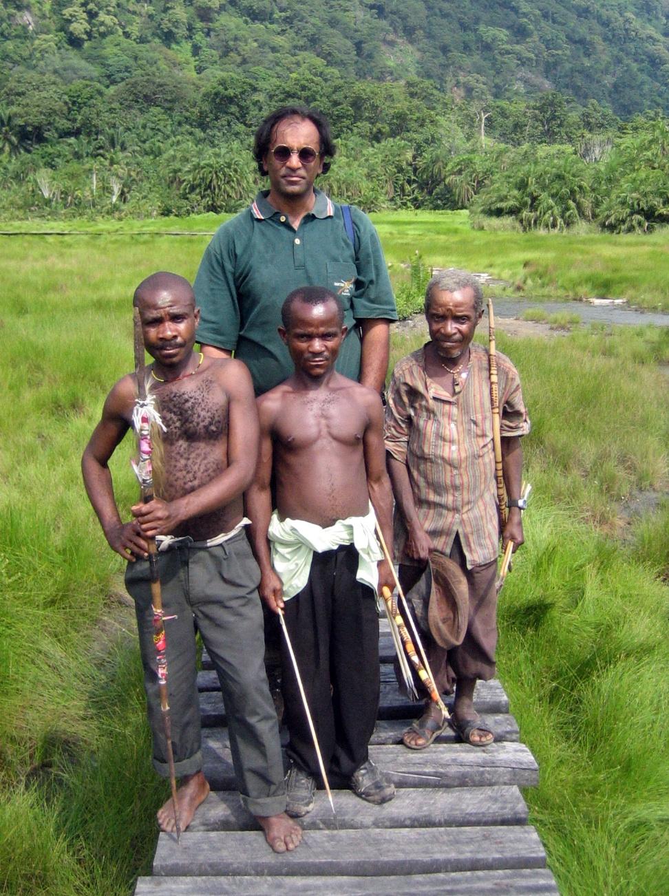 Hitesh with Batwa, a pygmy tribe, in Uganda.