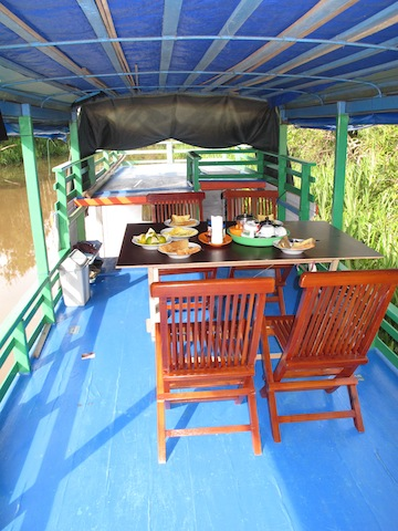 The two-story 'kelotok' is a great way to explore Kalimantan
