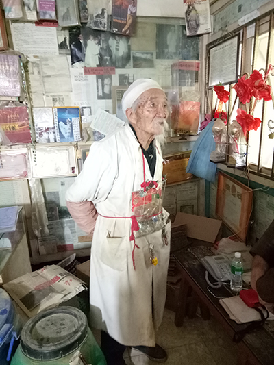 Dr Ho, acclaimed Chinese herbalist, in his studio