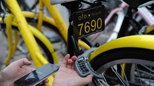 Riders download a smartphone app which links to an attached GPS tracker and the bicycle lock. Courtesy of ChinaFoto.