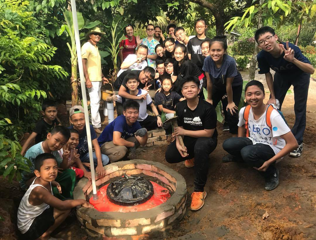 Students from Bedok Green Secondary School from Singapore get their hands dirty in building a Safe Water Garden for a family in Bintan, facilitated by LooLa Adventure Resort.