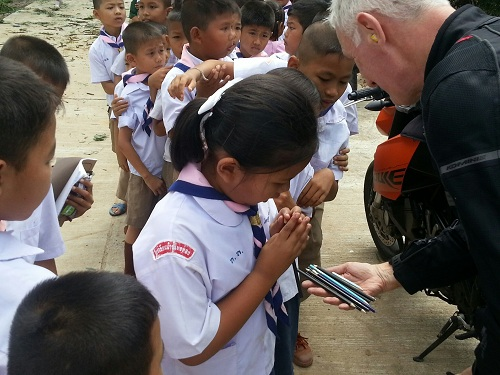 Pens and notebooks always get a great reception - and will benefit the whole community. Courtesy Teng Nee Peng