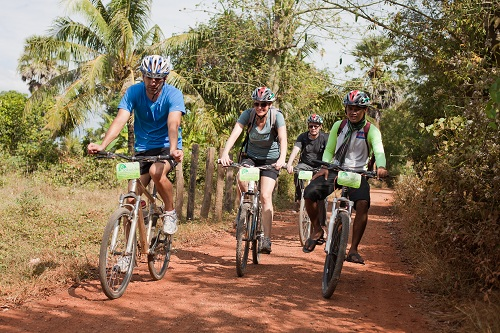 Cycling in rural Cambodia offers real access to local communities. Courtesy M. Wyse