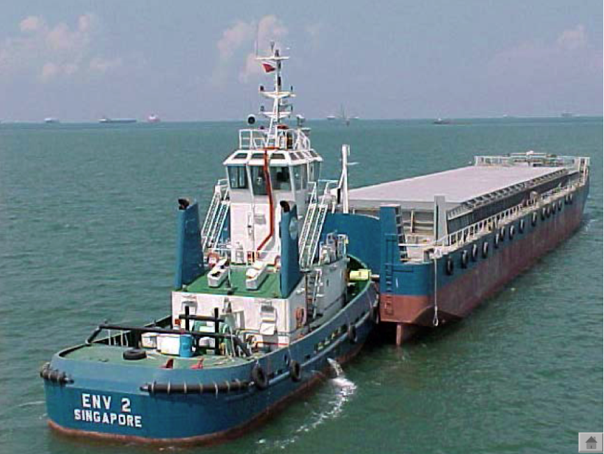 Six massive barges transfer thousands of tonnes of waste to Semakau every day. Image courtesy NEA.