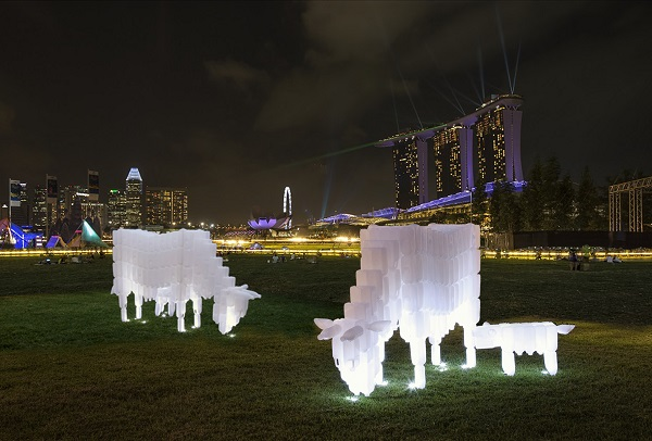 BP Loh's plastic milk bottle cows on display at i Light Marina Bay 2018 aims to promote trash re-use and upcycle messages. Image courtesy of BP Loh.