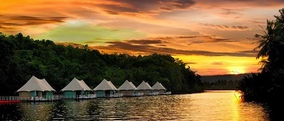 4 Rivers pontoons rest serenely on the Tatai River as the sun sets over the Cambodian jungle. And then the rains came . . . . Courtesy 4 Rivers.
