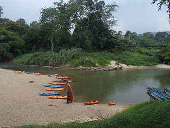 Kayak boats moored by the riverside. Photo Credit: Semadang Kayak