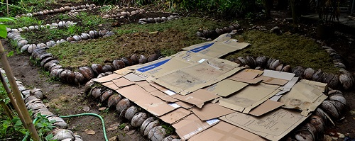 Alila's permaculture gardens use other waste streams to form the beds - like waste cardboard and coconut husks. Courtesy Alila.