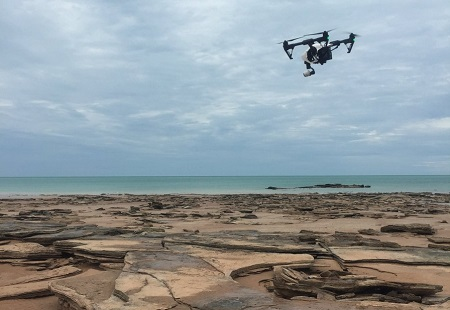 A drone looks for dinosaur footprints. Courtesy Twitter.