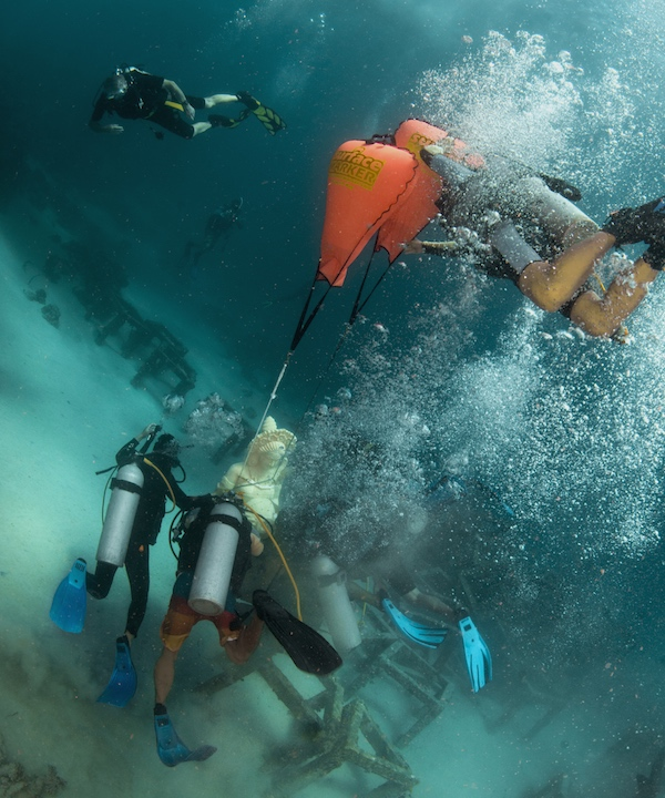 The sinking of the Lady with a Bowl sculpture is no easy feat, and is led by the commissioner Luley Dive Centre in Manado. Courtesy: Toar Pantouw